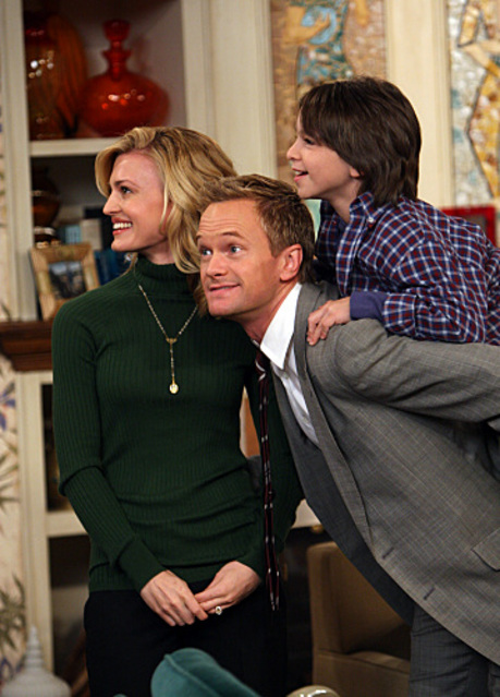 picture of Barney posing with his fake wife (Brooke D'Orsay) and his
